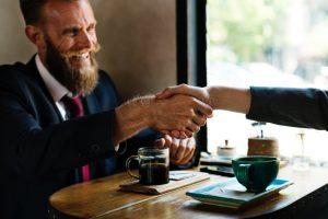 Man generating sales deal